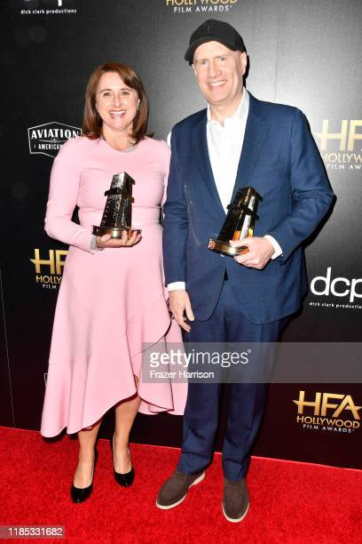 Victoria Alonso , winner of the Hollywood Blockbuster Award and Kevin Feige , winner of the Hollywood Blockbuster Award pose in the press room during...