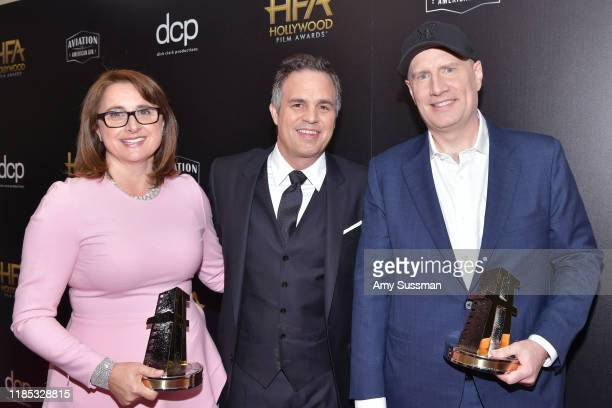 Victoria Alonso , winner of the Hollywood Blockbuster Award, Mark Ruffalo and Kevin Feige , winner of the Hollywood Blockbuster Award pose in the...