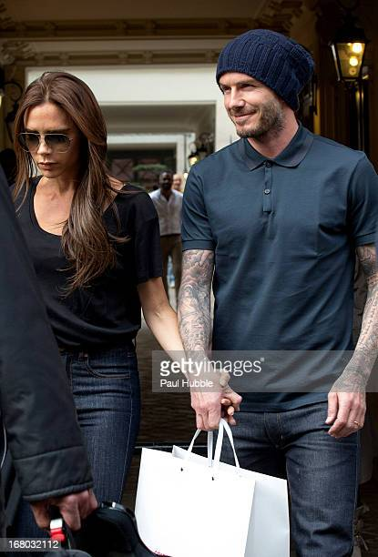 Victoria and David Beckham are seen leaving the 'Comme des garcons' store on May 4, 2013 in Paris, France.