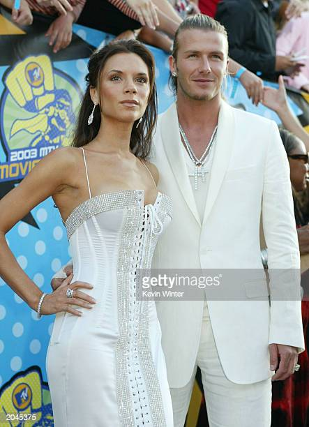 Victoria and David Beckham attend The 2003 MTV Movie Awards held at the Shrine Auditorium on May 31 2003 in Los Angeles California