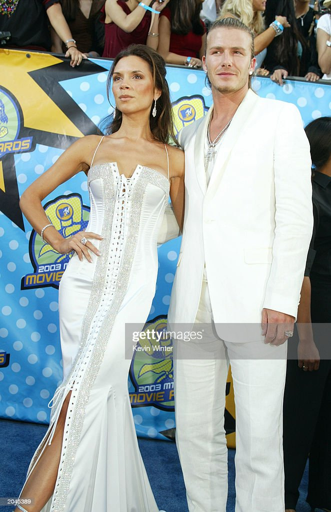 Victoria and David Beckham attends The 2003 MTV Movie Awards held at the Shrine Auditorium on May 31, 2003 in Los Angeles, California.