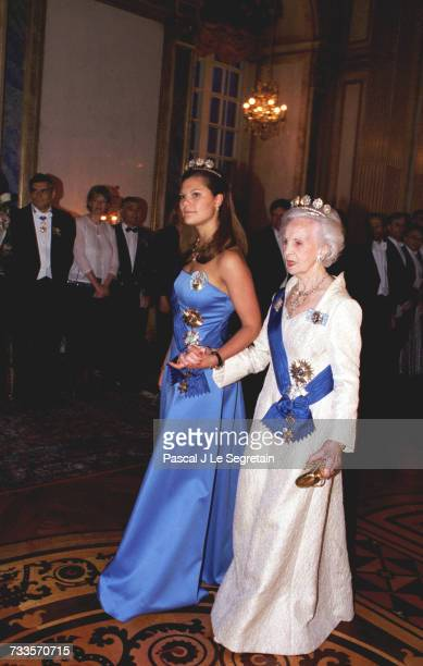 Victoria and Princess Lilian walking to the Charles XI gallery to attend the state banquet.