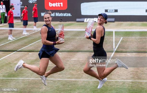 Victoria Azarenka and Aryna Sabalenka of Belarus celebrate with the trophy after winning the women's doubles final match against Demi Schuurs of...