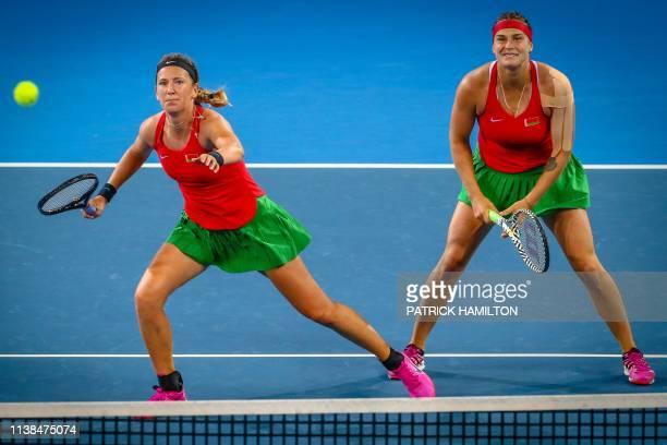Victoria Azarenka and Aryna Sabalenka of Belarus hit a return against Samantha Stosur and Ashleigh Barty of Australia during the Fed Cup tennis final...