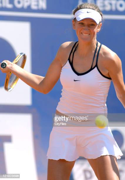 Victoria Azarenka hits a forehand during her match against Kristina Barrios during the Estoril Open on May 1 2006 in Lisbon Portugal
