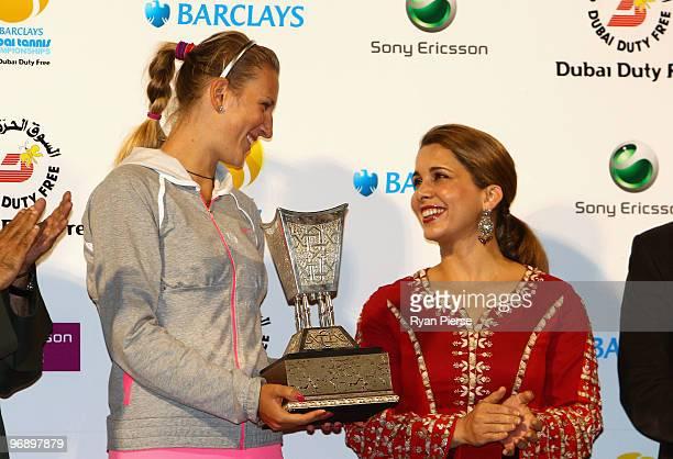 Victoria Azarenka of Belarus accepts her runner up trophy from Jordan's Princess Haya bint alHussein wife of Dubai ruler Sheikh Mohammed bin Rashed...