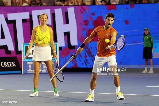 Victoria Azarenka of Belarus and Novak Djokovic of Serbia take part in the Rod Laver Arena Spectacular as part of Kids Tennis Day presented by...