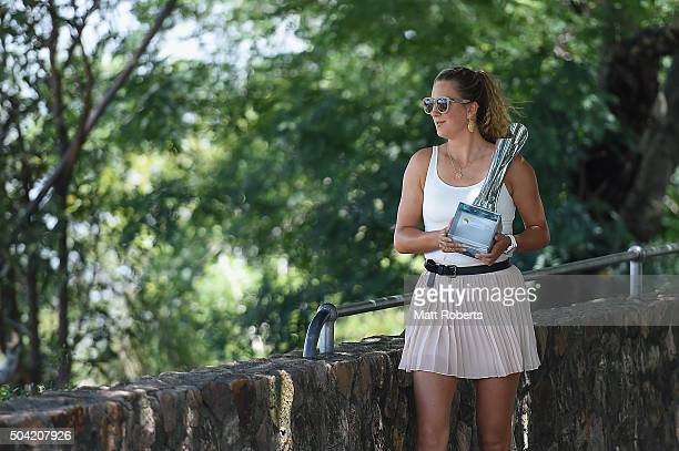 Victoria Azarenka of Belarus arrives holding Evonne Goolagong Cawley trophy at Kangaroo Point during day eight of the 2016 Brisbane International at...
