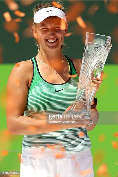 Victoria Azarenka of Belarus cekebrates with the Butch Buchholz Trophy after defeating Svetlana Kuznetsova of Russia during the women's final on Day...