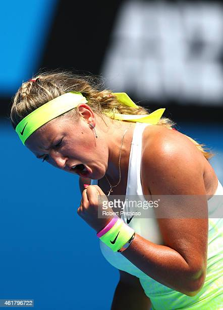 Victoria Azarenka of Belarus celebrates a point in her first round match against Sloane Stephens of the United States during day two of the 2015...