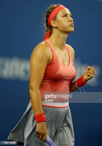 Victoria Azarenka of Belarus celebrates after defeating Daniela Hantuchova of Slovakia in a women's singles quarter final match on Day Ten of the...