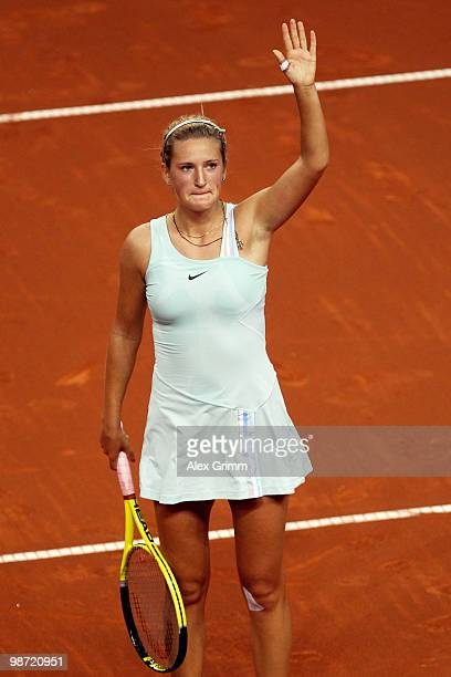 Victoria Azarenka of Belarus celebrates after winning her first round match against Flavia Pennetta of Italy at day three of the WTA Porsche Tennis...