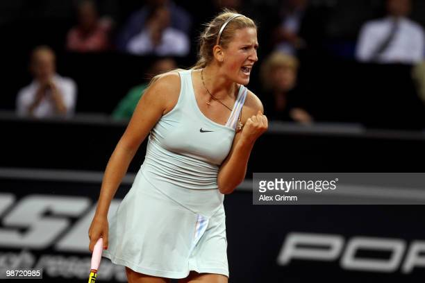 Victoria Azarenka of Belarus celebrates during her first round match against Flavia Pennetta of Italy at day three of the WTA Porsche Tennis Grand...