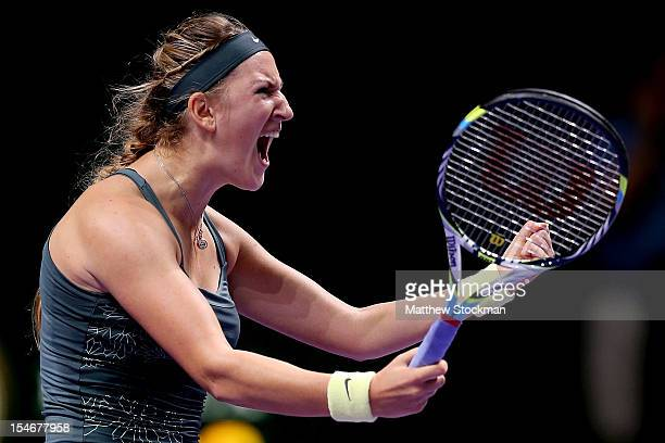 Victoria Azarenka of Belarus celebrates match point against Angelique Kerber of Germany in round robin play during the TEB BNP Paribas WTA...