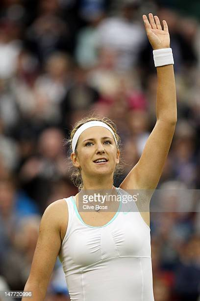 Victoria Azarenka of Belarus celebrates match point during her Ladies' singles fourth round match against Ana Ivanovic of Serbia on day seven of the...