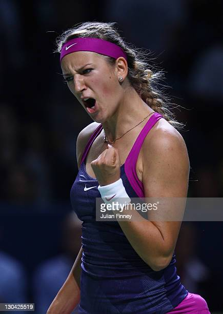 Victoria Azarenka of Belarus celebrates winning a game in her match against Samantha Stosur of Australia during day two of the season ending TEB BNP...