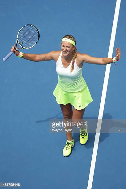 Victoria Azarenka of Belarus celebrates winning her first round match against Sloane Stephens of the United States during day two of the 2015...