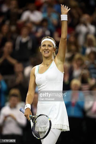 Victoria Azarenka of Belarus celebrates winning her Ladies' Singles quarterfinal match against Tamira Paszek of Austria on day eight of the Wimbledon...