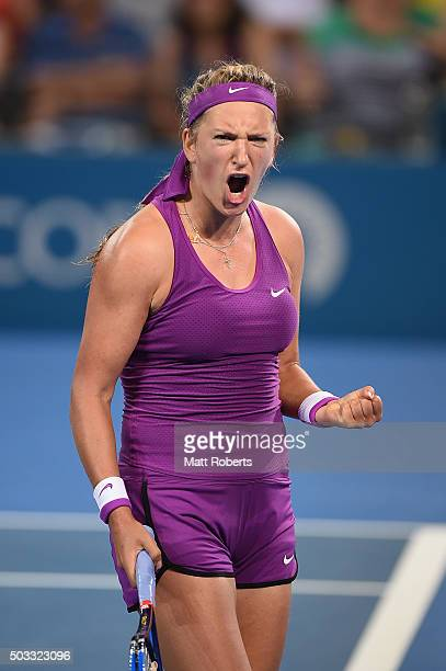 Victoria Azarenka of Belarus celebrates winning her match against Elena Vesnina of Russia during day two of the 2016 Brisbane International at Pat...
