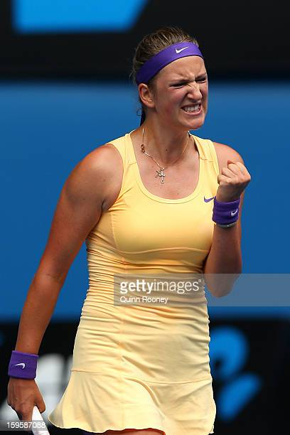 Victoria Azarenka of Belarus celebrates winning her second round match against Eleni Daniilidou of Greece during day four of the 2013 Australian Open...