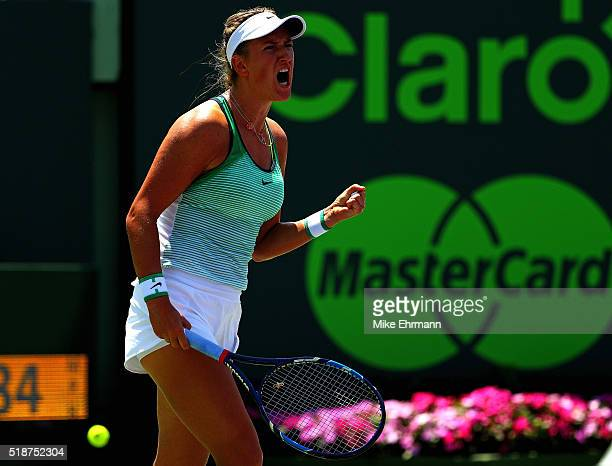 Victoria Azarenka of Belarus celebrates winning the first set in the Women's Final against Svetlana Kuznetsova of Russia during Day 13 of the Miami...