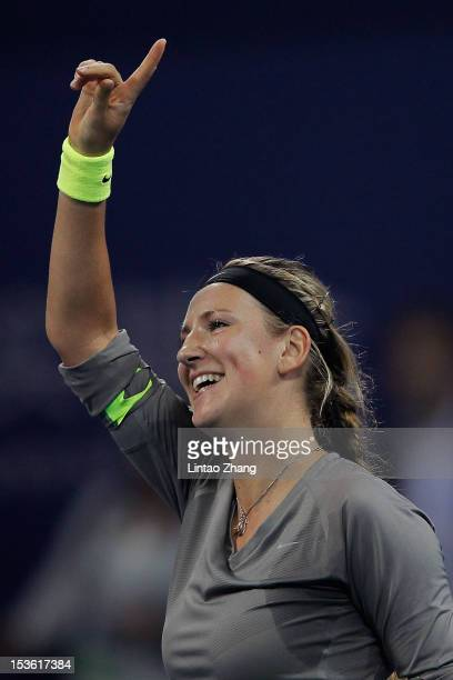 Victoria Azarenka of Belarus celebrates winning the Women's Singles Final match against Maria Sharapova of Russia during the China Open at the China...