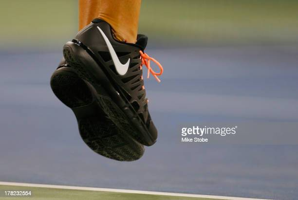 Victoria Azarenka of Belarus debuting a new Nike shoe during her women's singles first round match against Dinah Pfizenmaier of Germany on Day Two of...