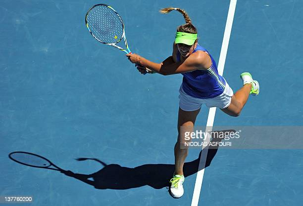 Victoria Azarenka of Belarus hits a volley against Kim Clijsters of Belgium in their women's singles semifinal match on day 11 of the 2012 Australian...