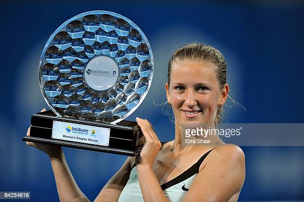 Victoria Azarenka of Belarus holds up the trophy after beating Marion Bartoli of France in the women's finals match on day seven of the Brisbane...