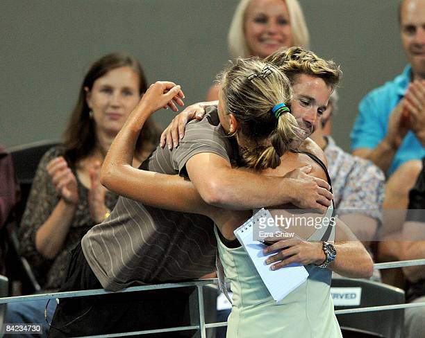 Victoria Azarenka of Belarus hugs her coach Antonio Van Grichen after beating Marion Bartoli of France in the women's finals match on day seven of...