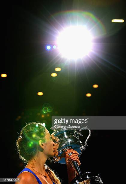 Victoria Azarenka of Belarus kisses the Daphne Akhurst Memorial Cup after winning her women's final match against Maria Sharapova of Russia and being...