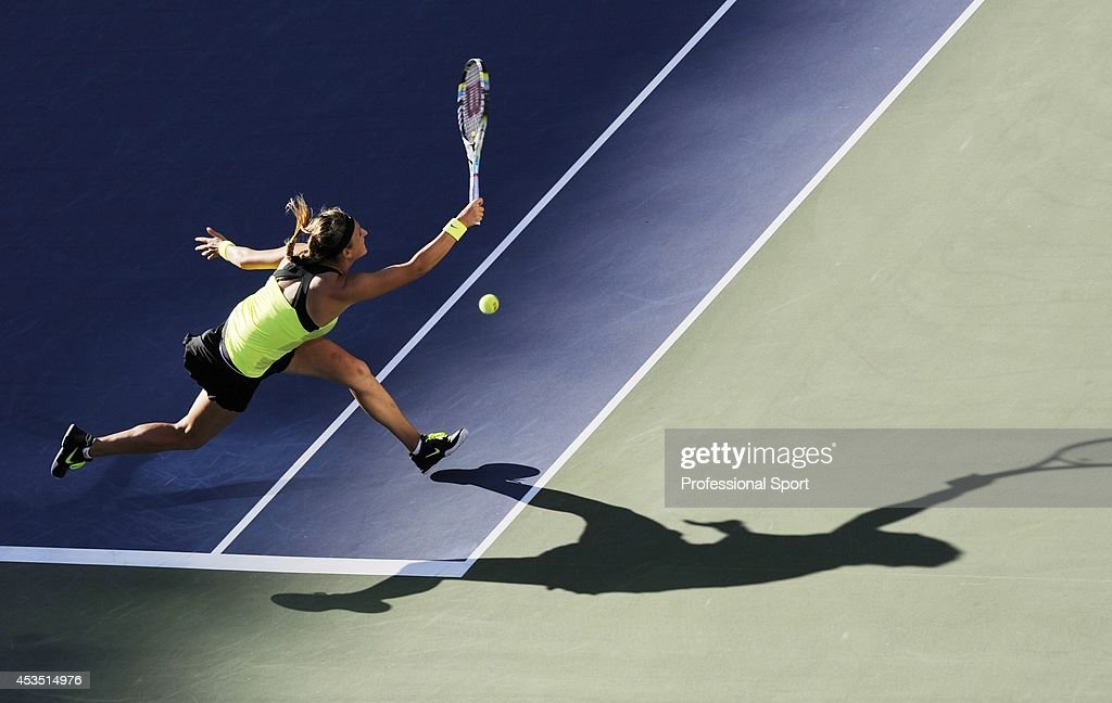 Victoria Azarenka of Belarus makes a running forehand return during the women's singles final match against Serena Williams of the United States on Day Fourteen of the 2012 U.S. Open at the USTA Billie Jean King National Tennis Center on September 9, 2012 in the Flushing neighborhood, of the Queens borough of New York City.