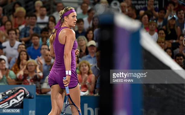 Victoria Azarenka of Belarus moves to the other side of the court to receive a serve against Roberta Vinci of Italy during their women's singles...