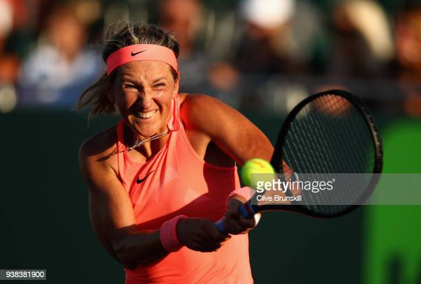 Victoria Azarenka of Belarus plays a backhand against Agnieszka Radwanska of Poland in their fourth round match during the Miami Open Presented by...