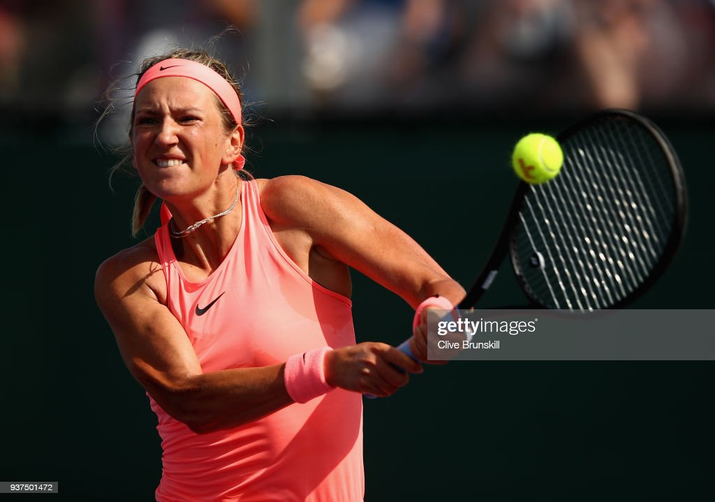 Victoria Azarenka of Belarus plays a backhand against Anastasija Sevastova of Latvia in their third round match during the Miami Open Presented by Itau at Crandon Park Tennis Center on March 24, 2018 in Key Biscayne, Florida.