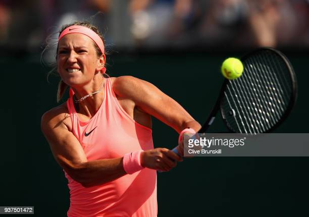 Victoria Azarenka of Belarus plays a backhand against Anastasija Sevastova of Latvia in their third round match during the Miami Open Presented by...