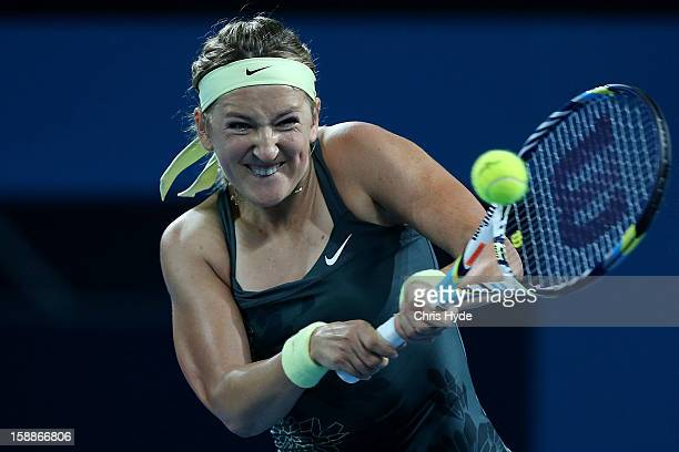 Victoria Azarenka of Belarus plays a backhand during her game against Sabine Lisicki of Germany on day four of the Brisbane International at Pat...