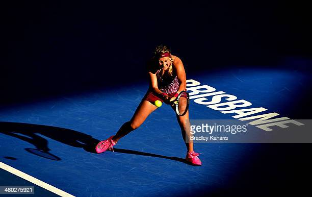 Victoria Azarenka of Belarus plays a backhand in her match against Jelena Jankovic of Serbia during day six of the 2014 Brisbane International at...