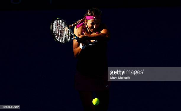 Victoria Azarenka of Belarus plays a backhand in her semi final match against Agnieszka Radwanska of Poland during day five of the 2012 Sydney...