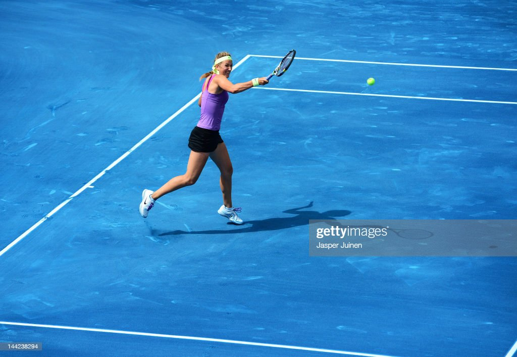 Victoria Azarenka of Belarus plays a backhand to Agnieszka Radwanske of Poland in her semi final match during the Mutua Madrilena Madrid Open tennis tournament at the Caja Magica on May 12, 2012 in Madrid, Spain.