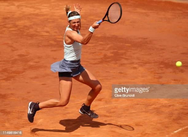 Victoria Azarenka of Belarus plays a forehand against Karolina Pliskova of the Czech Republic in their Women's Singles quarter final match during Day...