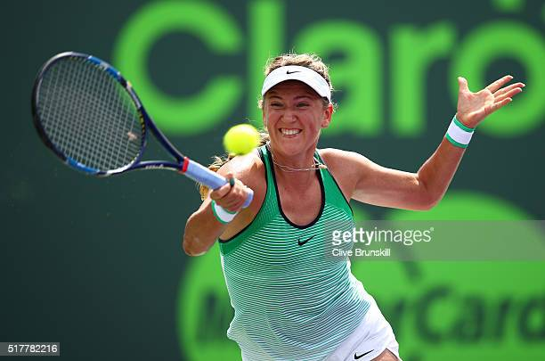 Victoria Azarenka of Belarus plays a forehand against Magda Linette of Poland in their third round match during the Miami Open Presented by Itau at...