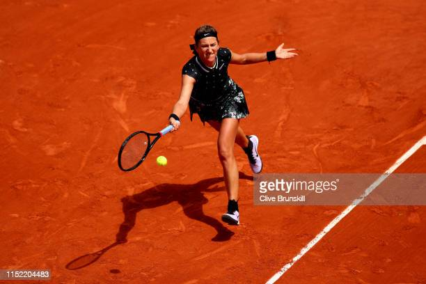 Victoria Azarenka of Belarus plays a forehand during her ladies singles first round match against Jelena Ostapenko of Latvia during Day three of the...