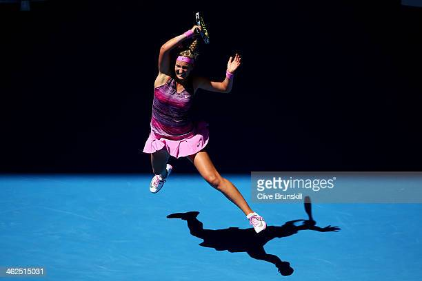 Victoria Azarenka of Belarus plays a forehand in her first round match against Johanna Larsson of Sweden during day two of the 2014 Australian Open...