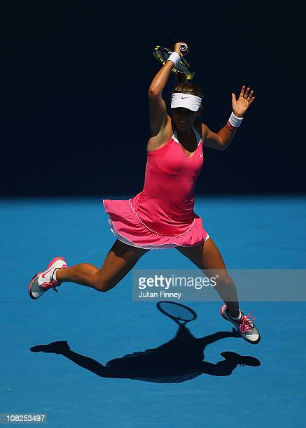 Victoria Azarenka of Belarus plays a forehand in her fourth round match against Na Li of China during day seven of the 2011 Australian Open at...