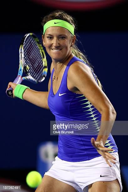 Victoria Azarenka of Belarus plays a forehand in her second round match against Casey Dellacqua of Australia during day three of the 2012 Australian...