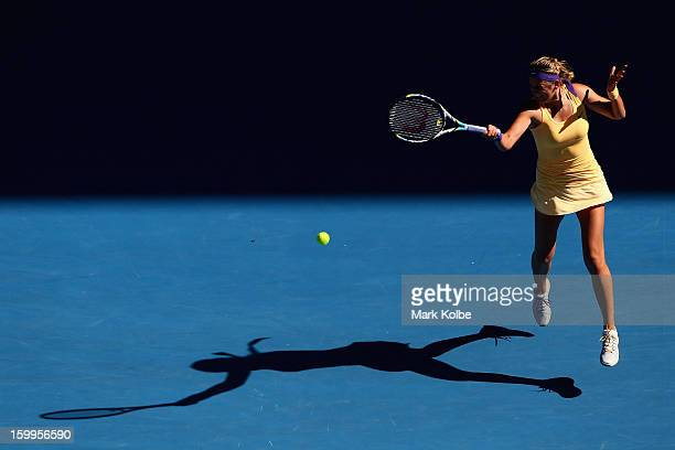 Victoria Azarenka of Belarus plays a forehand in her Semifinal match against Sloane Stephens of the United States during day eleven of the 2013...