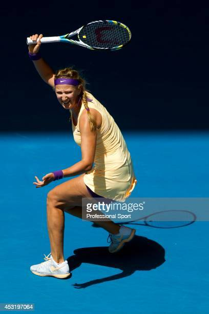 Victoria Azarenka of Belarus plays a forehand in her third round match against Jamie Hampton of the United States during day six of the 2013...