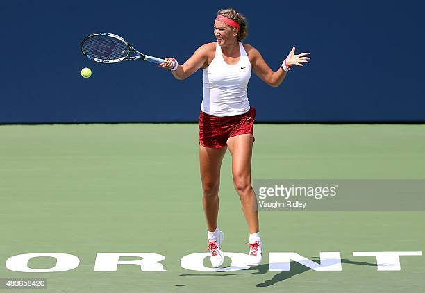 Victoria Azarenka of Belarus plays a shot against Elina Svitolina of Ukraine during Day 2 of the Rogers Cup at the Aviva Centre on August 11 2015 in...