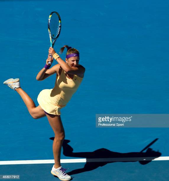 Victoria Azarenka of Belarus plays a two-handed backhand in her Quarterfinal match against Svetlana Kuznetsova of Russia during day ten of the 2013...